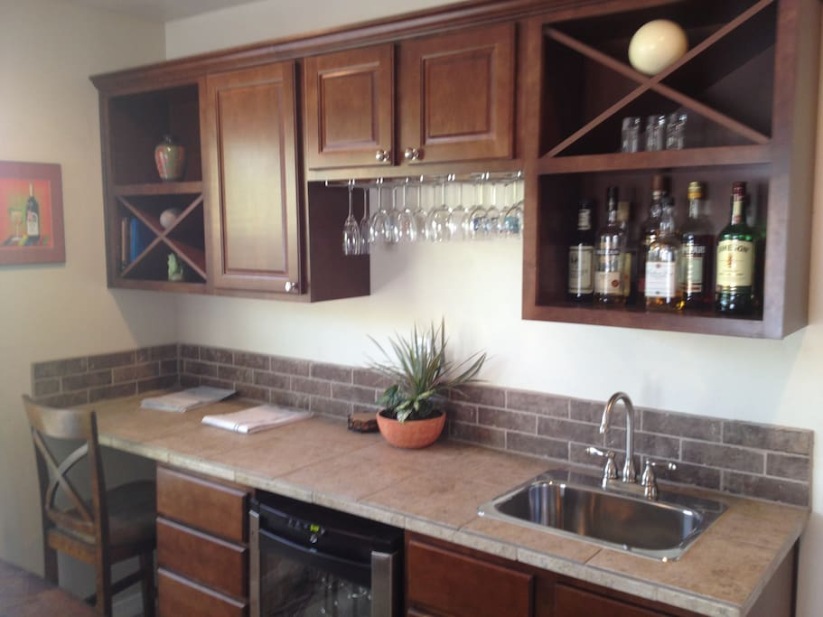 Wet bar with wine chiller and extra sitting area.
