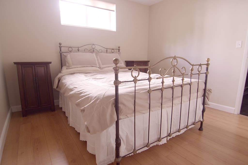 Brand new, top of the line bed and box add comfort to the antique bed frame and side tables. Two closets in this room and space under the bed to hide luggage.