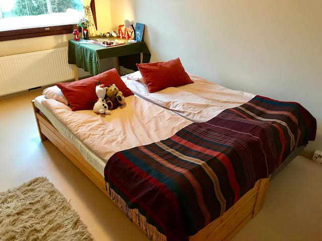 Two beds with available pillows, blankets, towels