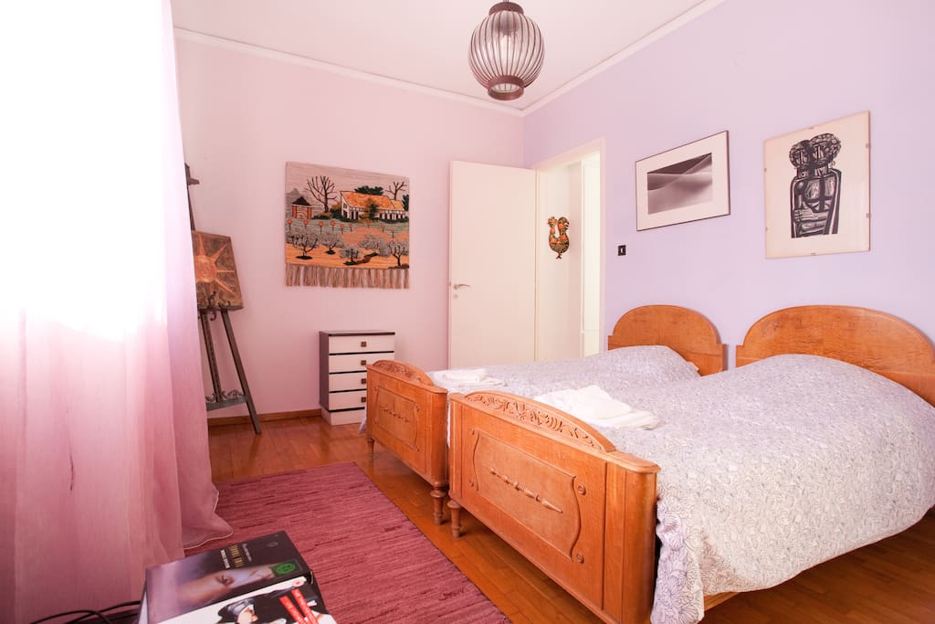 This is the violet bedroom with 2 single beds, window and small veranda with view of the sea