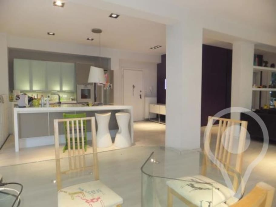 Open plan italian designed kitchen fully equipped.