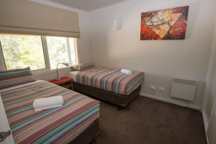 Two single beds in third bedroom