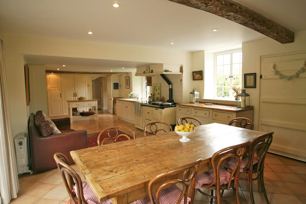 Large family kitchen with doors into garden