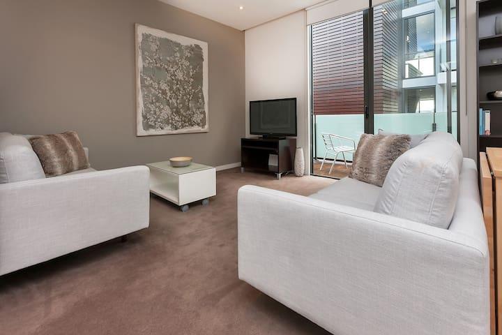 Living area opens onto a small balcony