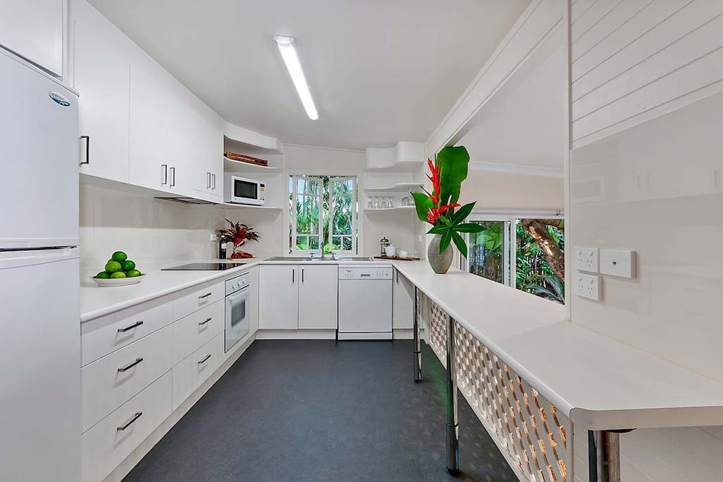 Fully equipped kitchen, recently renovated with modern appliances including a dishwasher.
