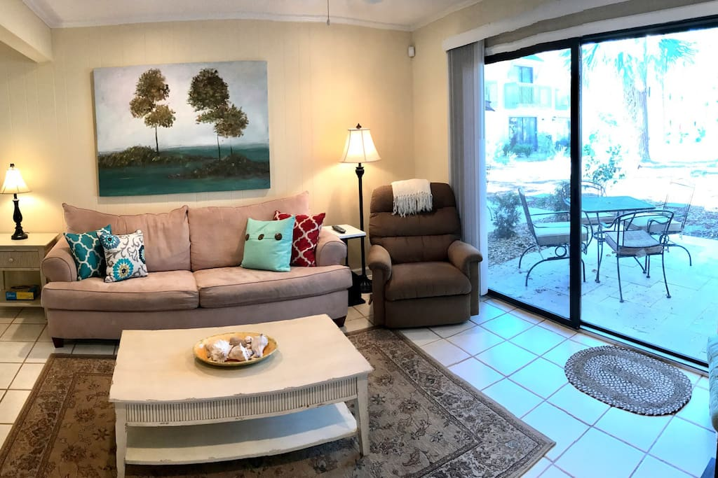 The indoor living area is adjacent to the outdoor living space.