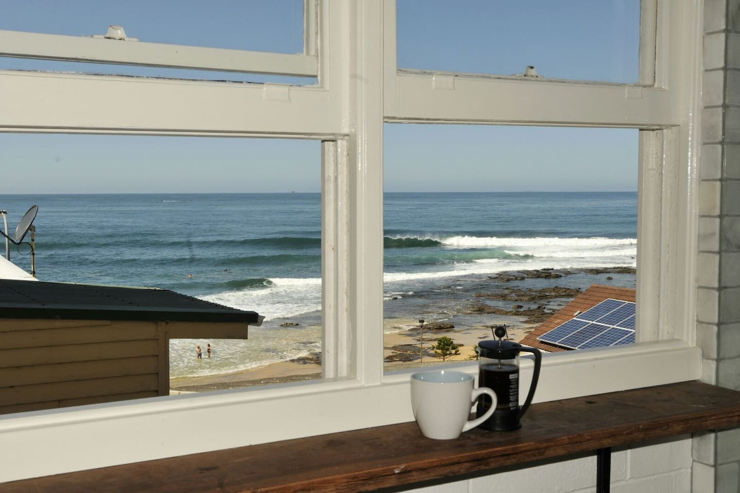 Drink your coffee while watching the surf or the whales going by.