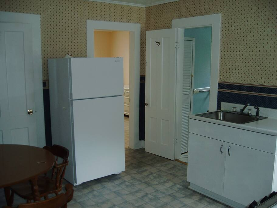 Full Kitchen with microwave, coffee maker, toaster and ref