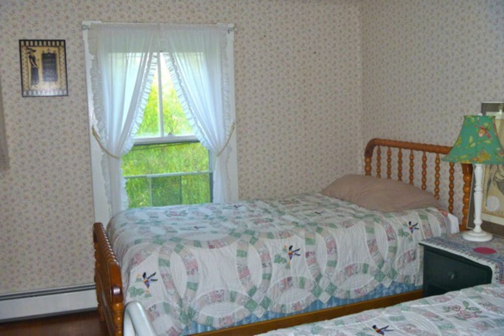 Twin beds in sunny southwest-facing bedroom