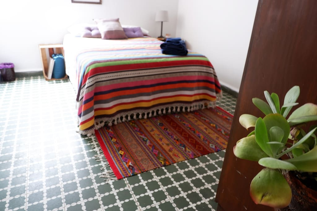 The Green Room: Internal guest room w/ Oaxacan textiles, sound machine, essential oils, 100% cotton sheets & high quality towels