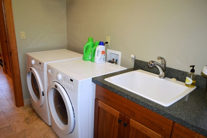 Upper level laundry room with front load washer/dryer