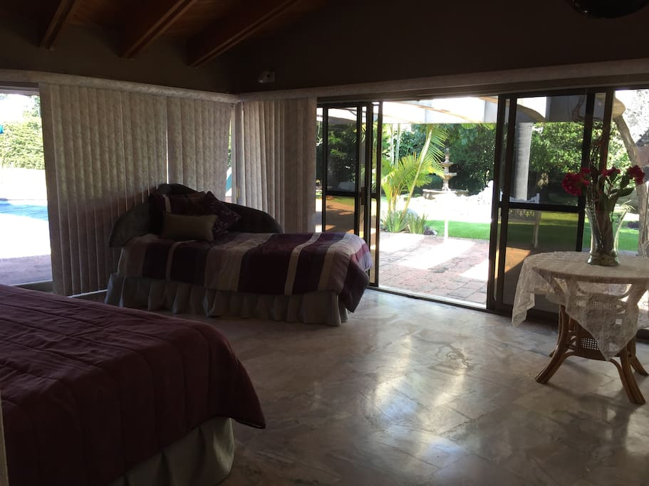 Master Bedroom with 180 degrees view of the garden and pool