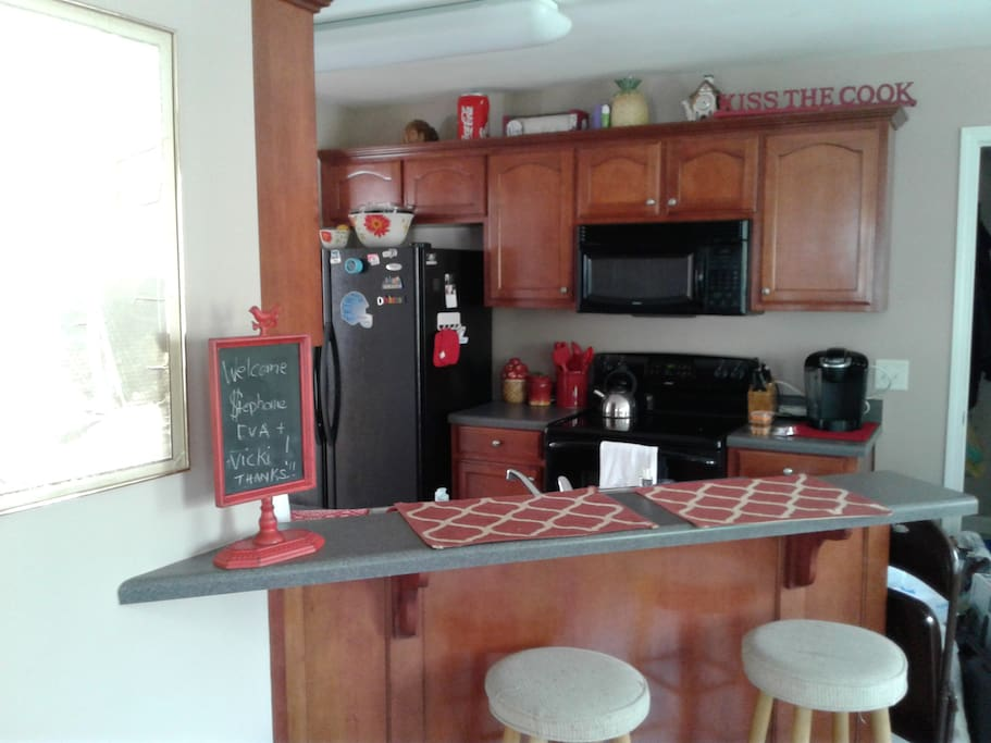 Kitchen is well-equipped with bar seating.  Open floor plan!
