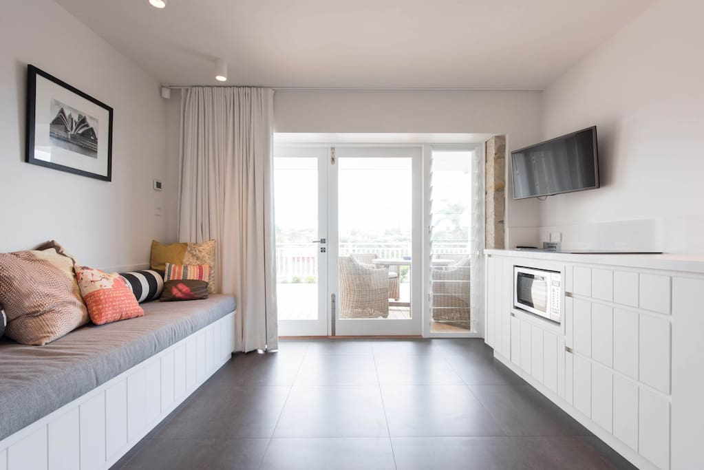 Living space with day bed and kitchen