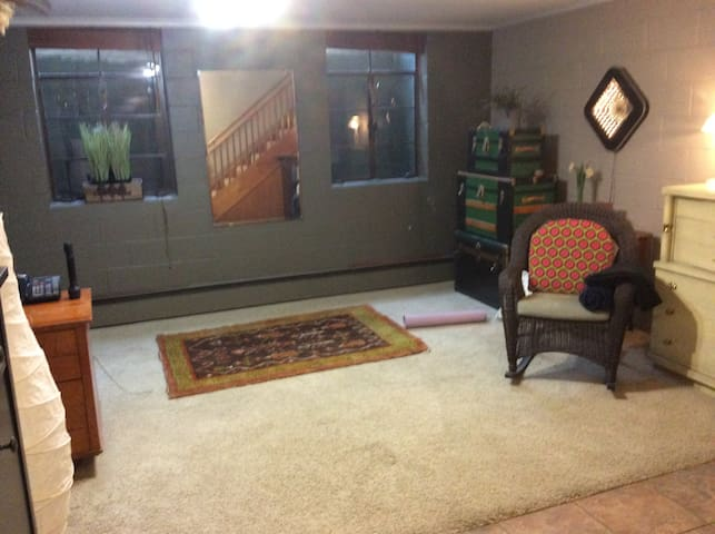 Yoga and meditation room at lower level; shared office desk nearby.