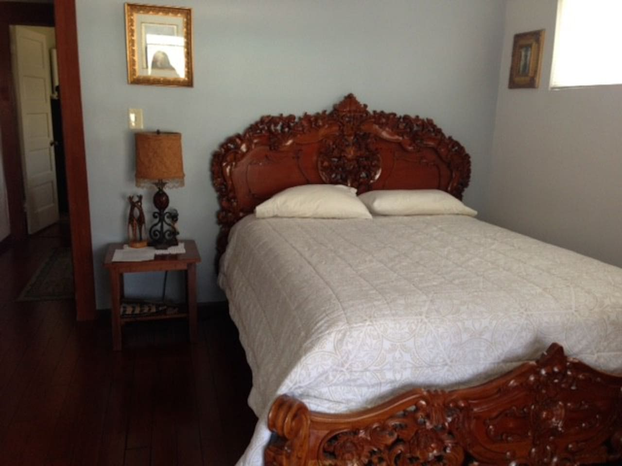 Your cozy, comfortable room with a beautiful Balinese bed.