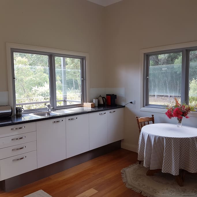 Kitchenette with full oven and stove.