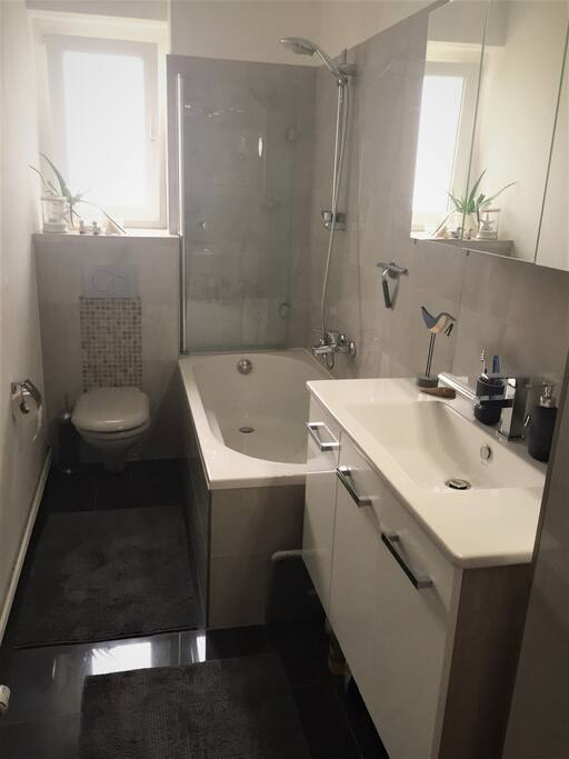 Freshly renovated bathroom with bathtub