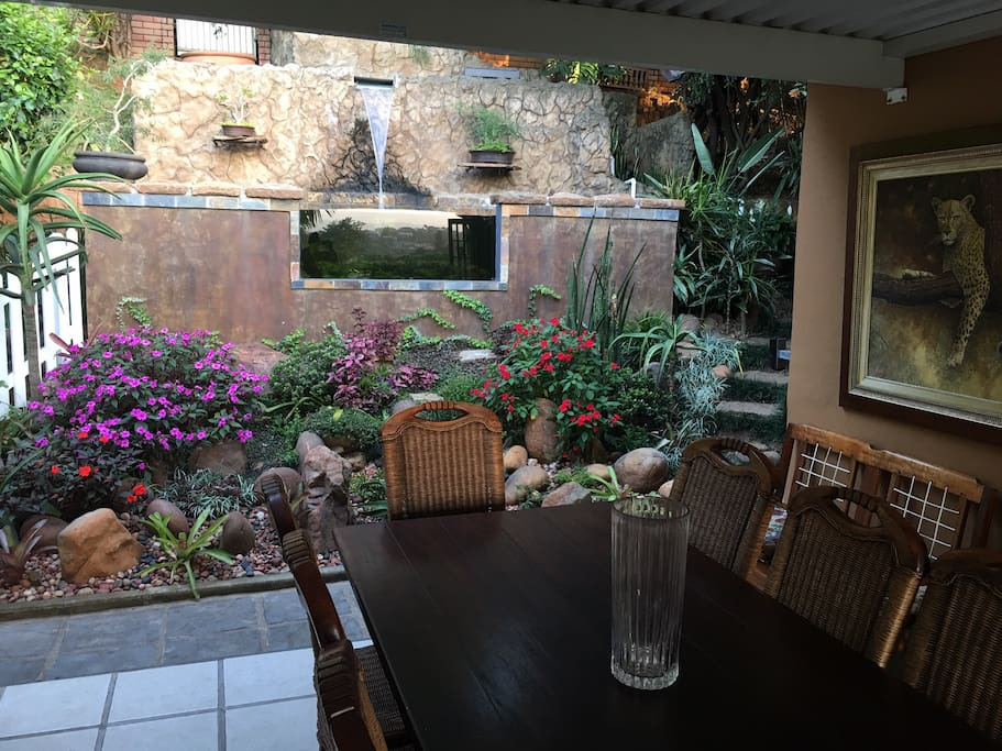 The outdoor verandah and fish pond area.
