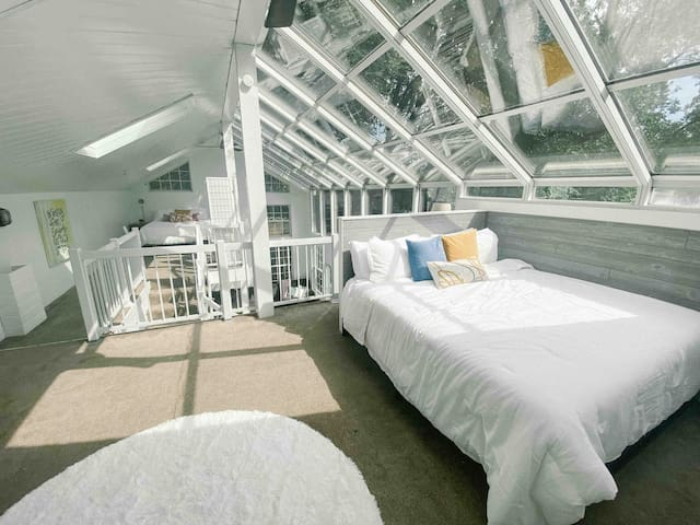 The upstairs loft features both a queen + king bed with perfect views for sleeping under the stars!