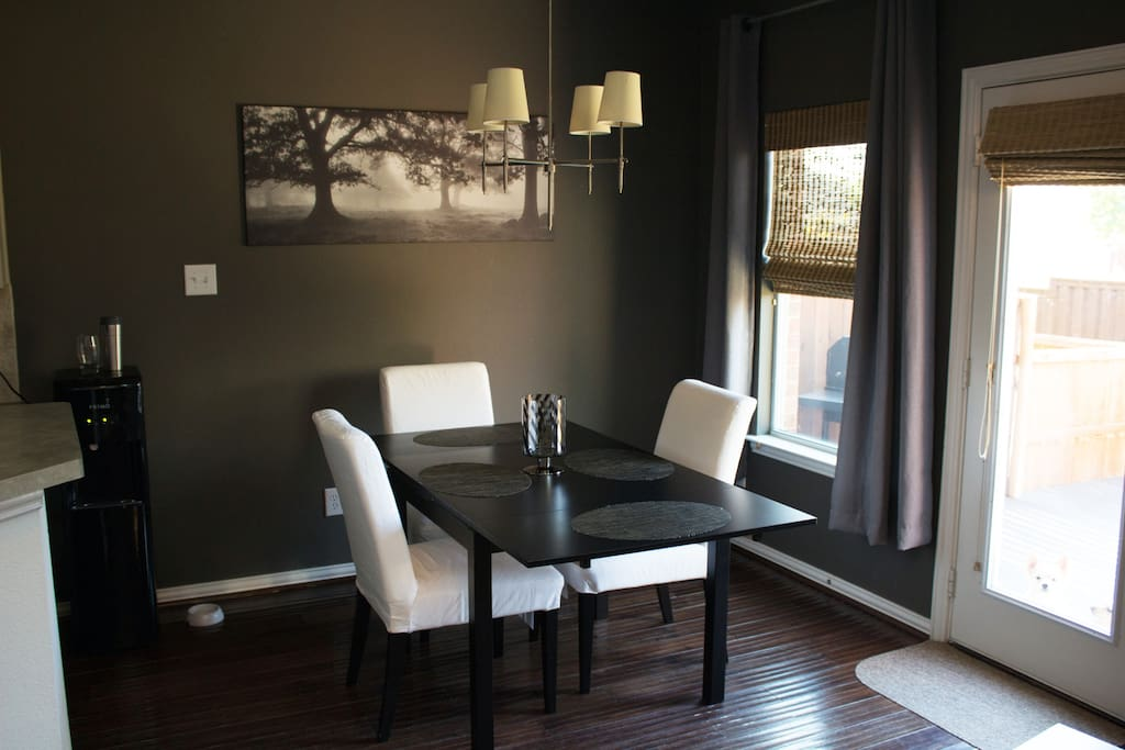 Dining room with door to backyard