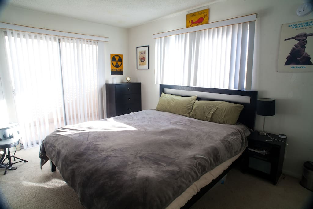 Bedroom with lots of natural light and a great breeze.   Comfortable, memory foam, California King bed.