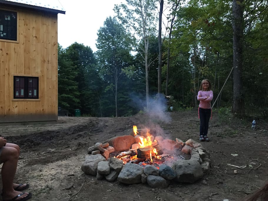 Campfire area behind house.
