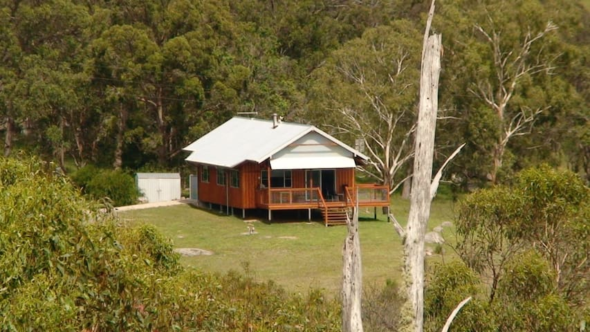 Nestled in 125 acres of mixed forest and open land.