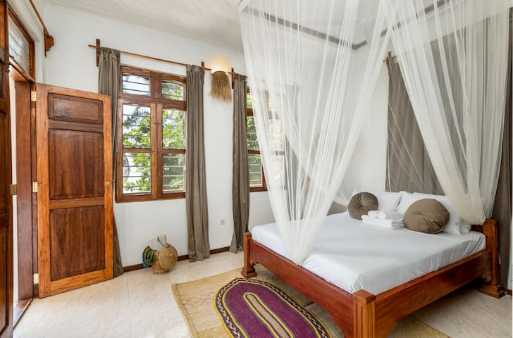 Oceanview bedroom with direct access to the terrace.