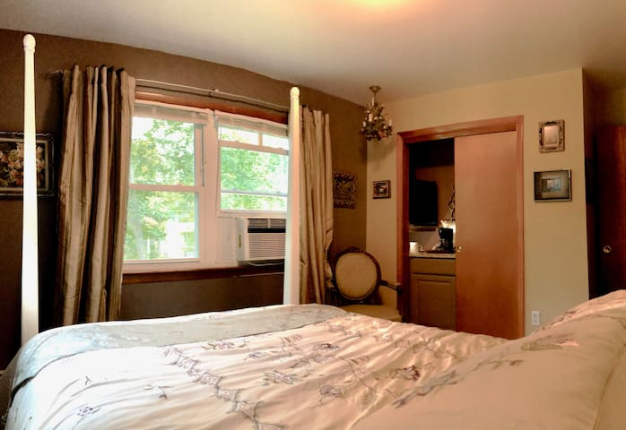 Pretty view room with new bed, small fridge & coffee maker.