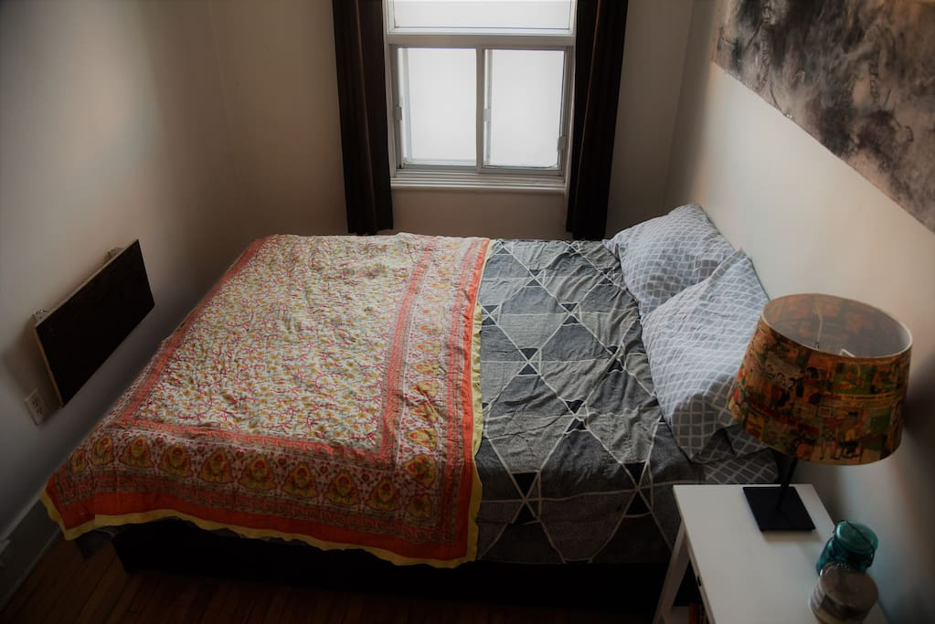 Guest room, super sunny, with blackout curtains for sleeping in.
