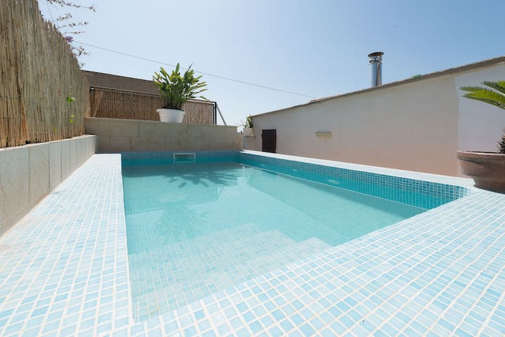 CASA LLUBI - Modern and central townhouse with private pool.