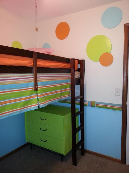 Loft bed provides additional space for better use of room.