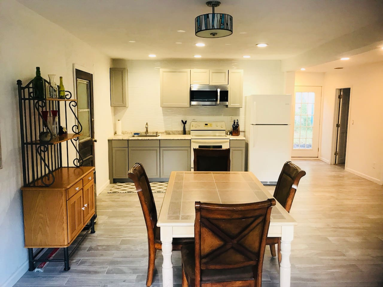 It is very clean-open kitchen and dining area