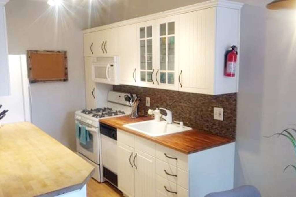Kitchen includes a gas stove, microwave, full ref/freezer, coffee maker and small dishwasher