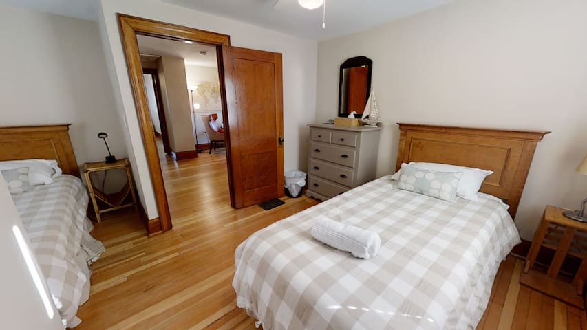 This bedroom with two XL twin beds will work for couples, friends or kids.