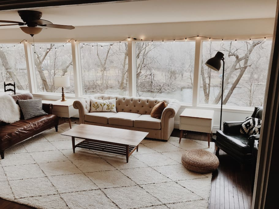 Large windows allow lots of natural light into this cozy Sun Room