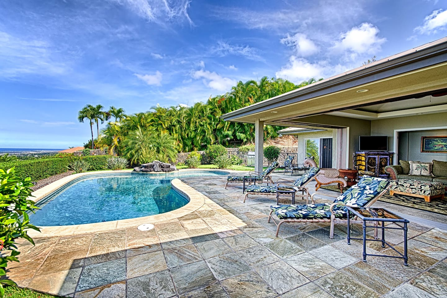 Hale Aikane-Spacious partially covered Lanai with setting for the whole grou