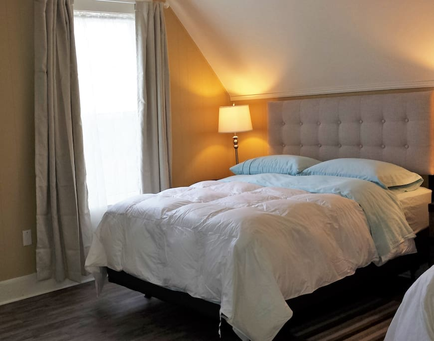 Full Size Bed Besides Window