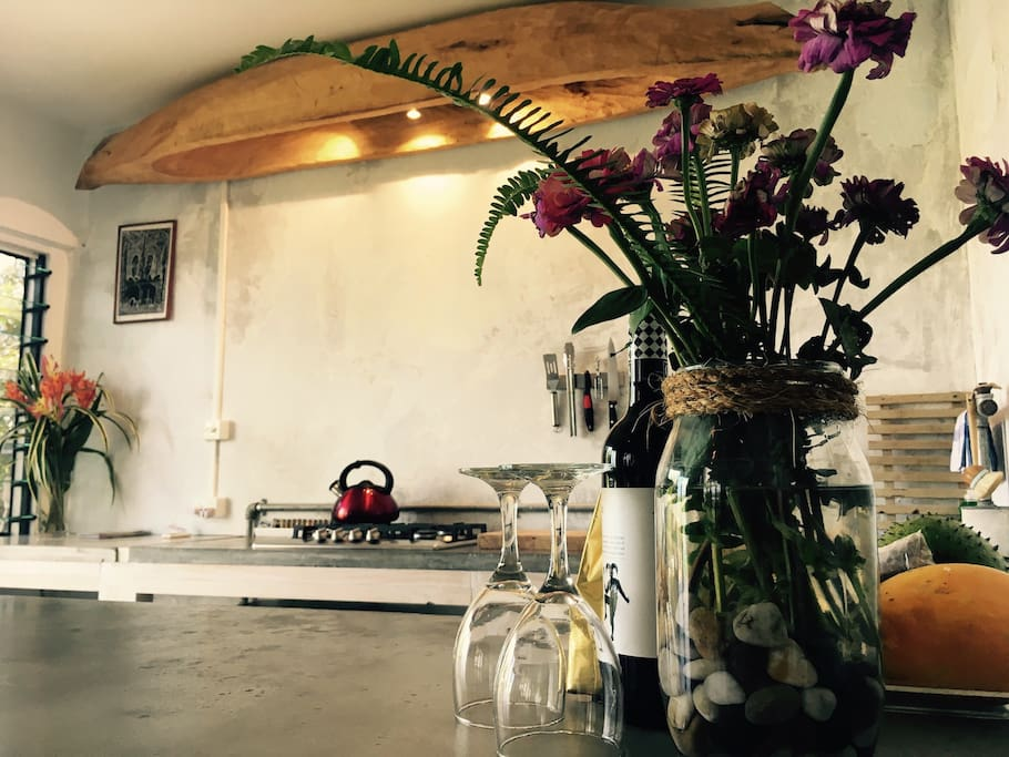 Enjoy our 'all you need' equipped kitchen with hand made concrete counter tops and bespoke canoe light fitting.