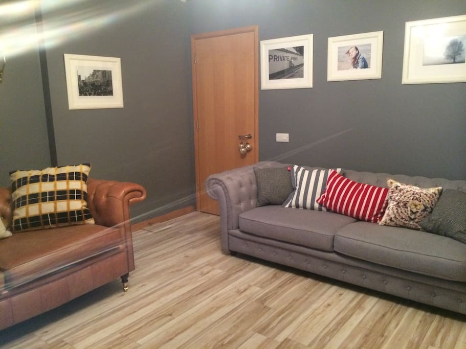 Sitting room. Under floor heating. Smart TV. Movie & Sport Channels all free. Balcony space and decking area off living room.