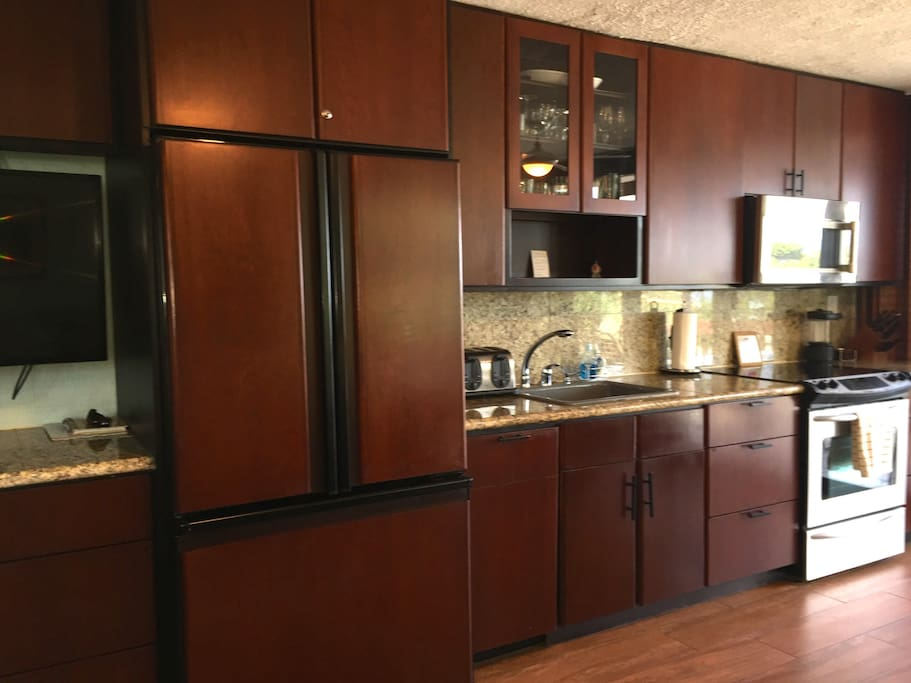 Kitchen with cherry cabinets and stainless steel appliances