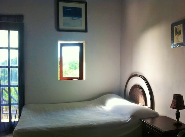Comfortable bedroom with built in wardrobes and leads to patio