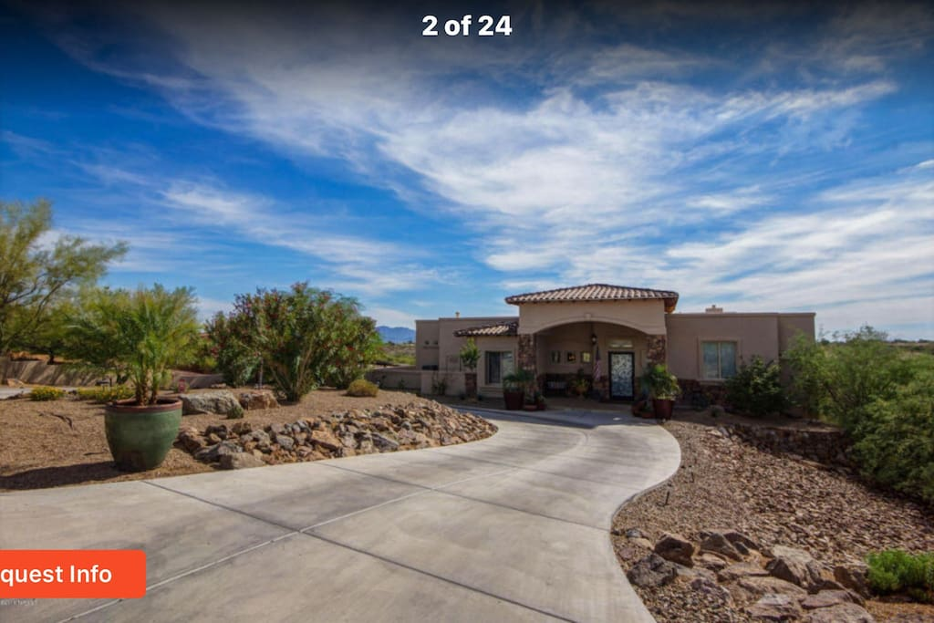 This is the front entrance of the home. The third  driveway is the entrance to the lower level. Owner uses circle drive.