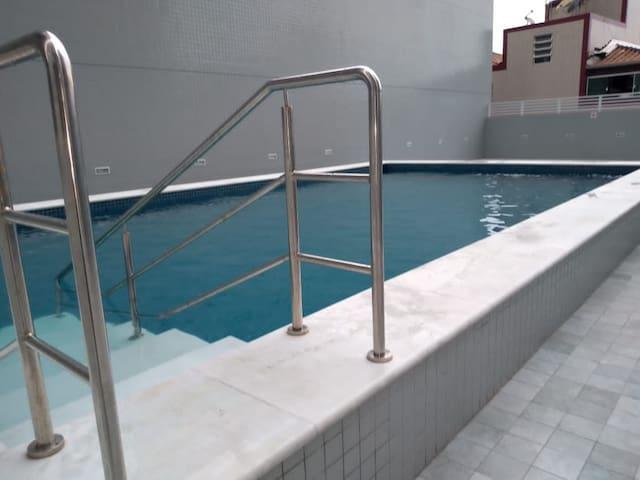Apto boqueirão,piscina, varanda gourmet 52 m praia