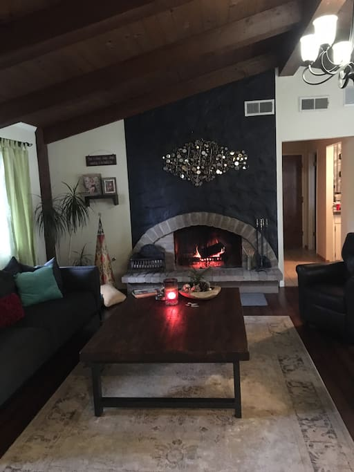 Family room with wood burning fireplace.
