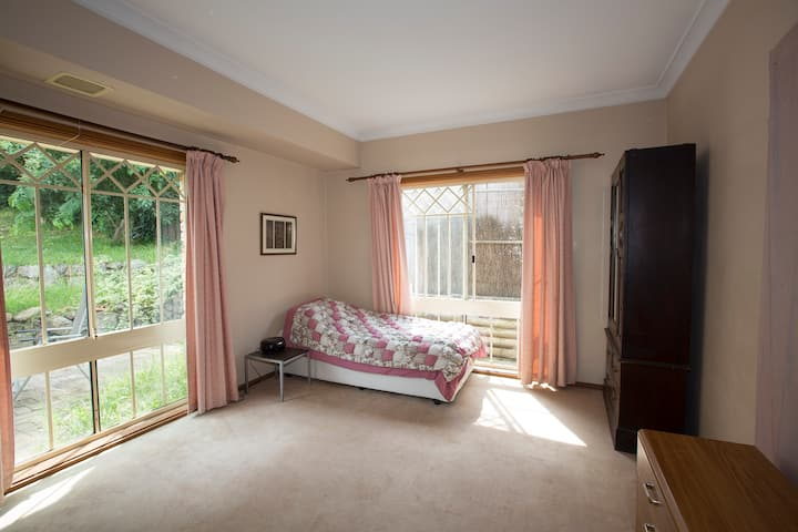 Comfortable room in large friendly home in WPH.