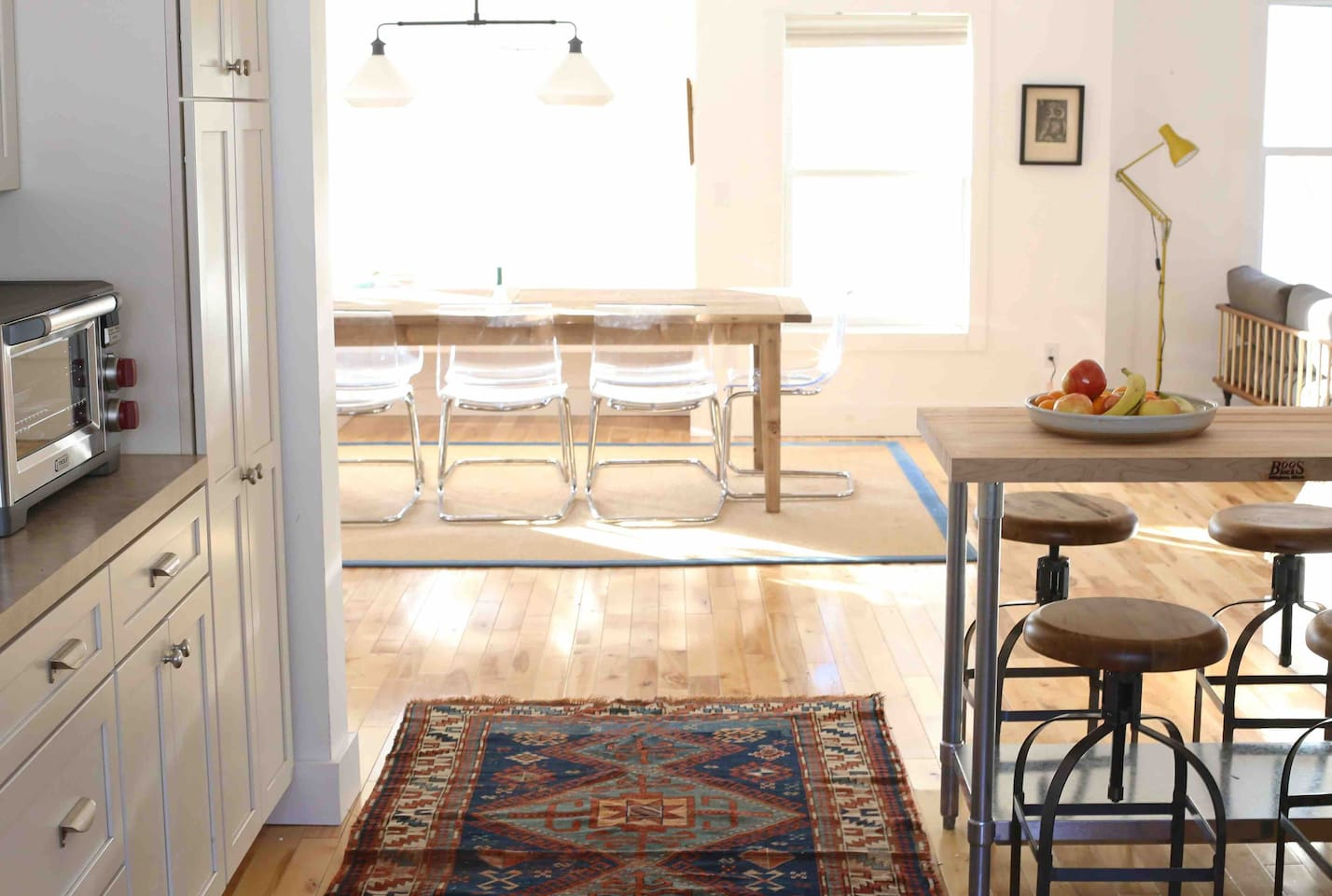 A view from the kitchen. We have a brand new Wolf toaster oven, four swivel stools at the island and our French bakery table from England that seats up to 12. Additional chairs are in the large laundry room.