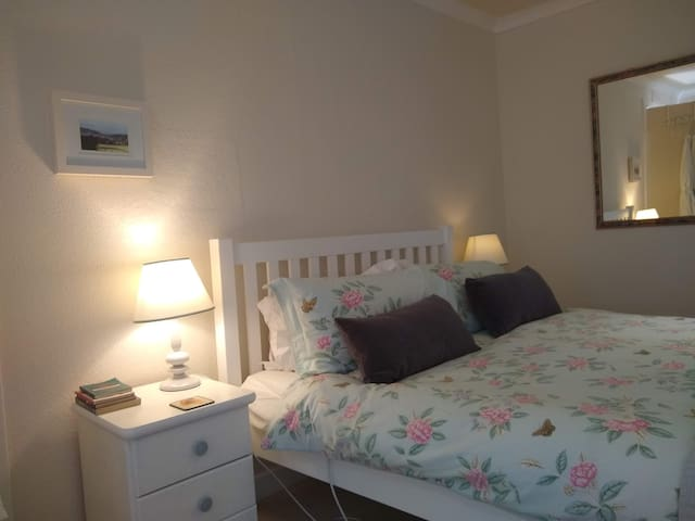 A comfortable double bed, with heating pads and reading lamps.