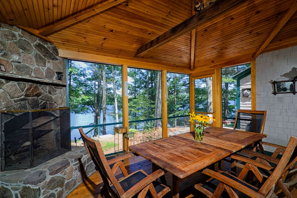 We practically live out here in the summer.  Right off the kitchen with a big table, lake views and a large stone fireplace; it's pretty great.